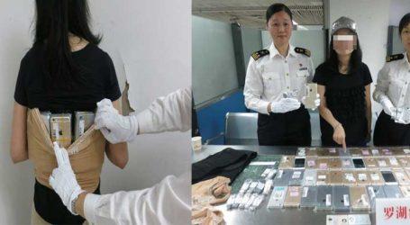 કમર પર બાંધીને લઇ જઇ રહી હતી 102 iPhones, પોલીસે કરી ધરપકડ